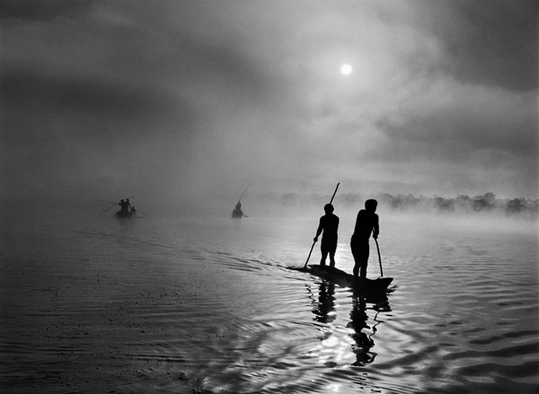 In the Upper Xingu region of Brazil's Mato Grosso state, a group of waura fish in the Piulaga Lake near their village. The Upper Xingu Basin is home to an ethnically diverse population. Brazil, 2005. © Sebastião Salgado / Amazonas Images / nbpictures