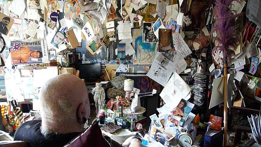 Drako's flat. Posters.