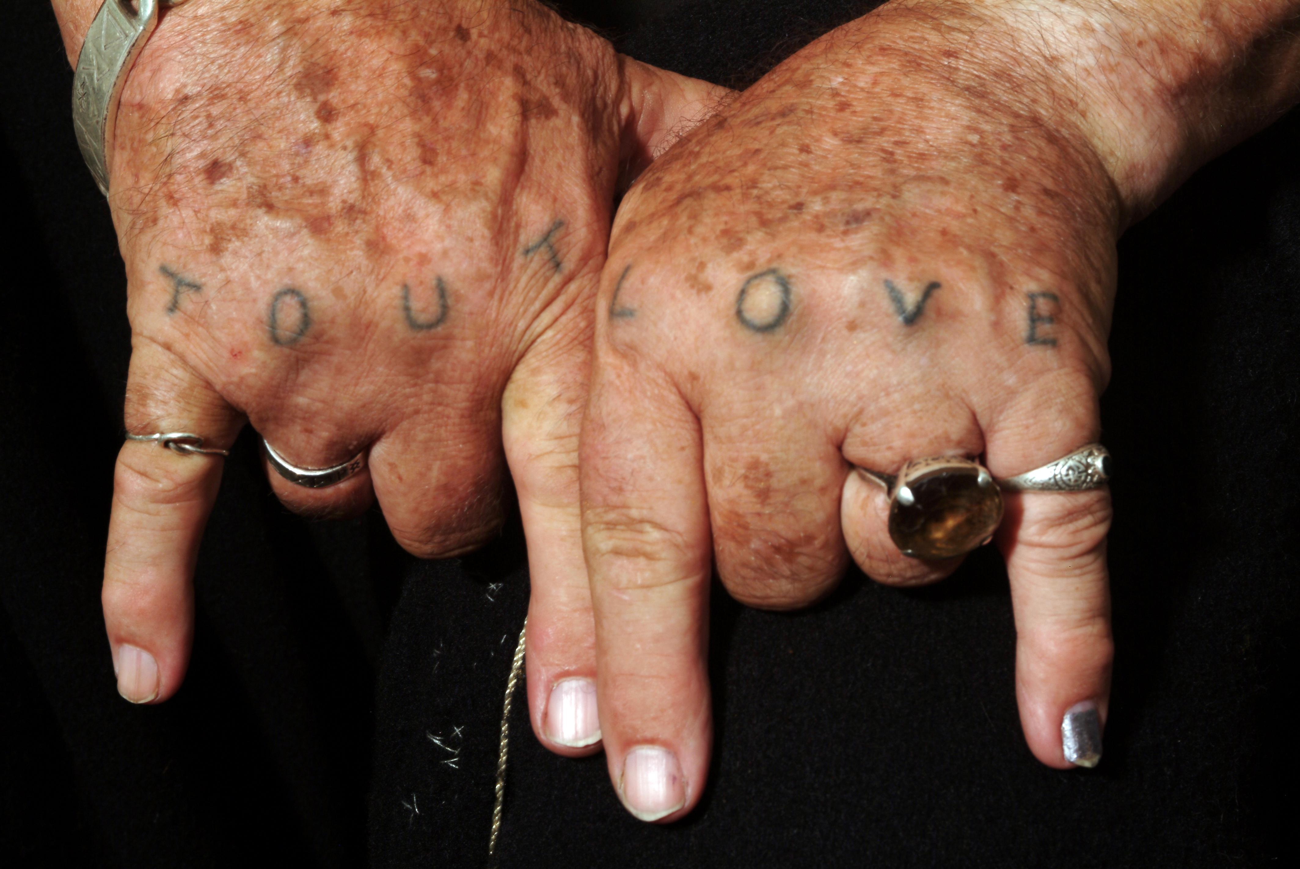 Tout Love hands tattoo