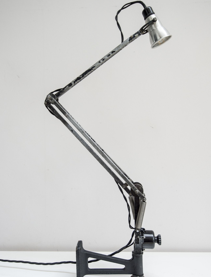 Anglepoise lamp restored from a Wellington bomber plane and white background