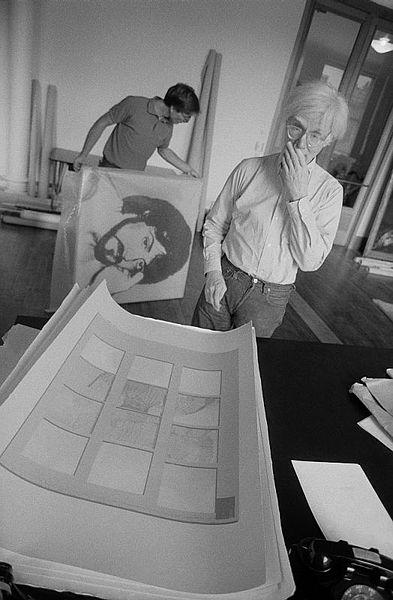 Andy Warhol looking at Thomas Dellert banana split, 1980 by Bruno Ehrs
